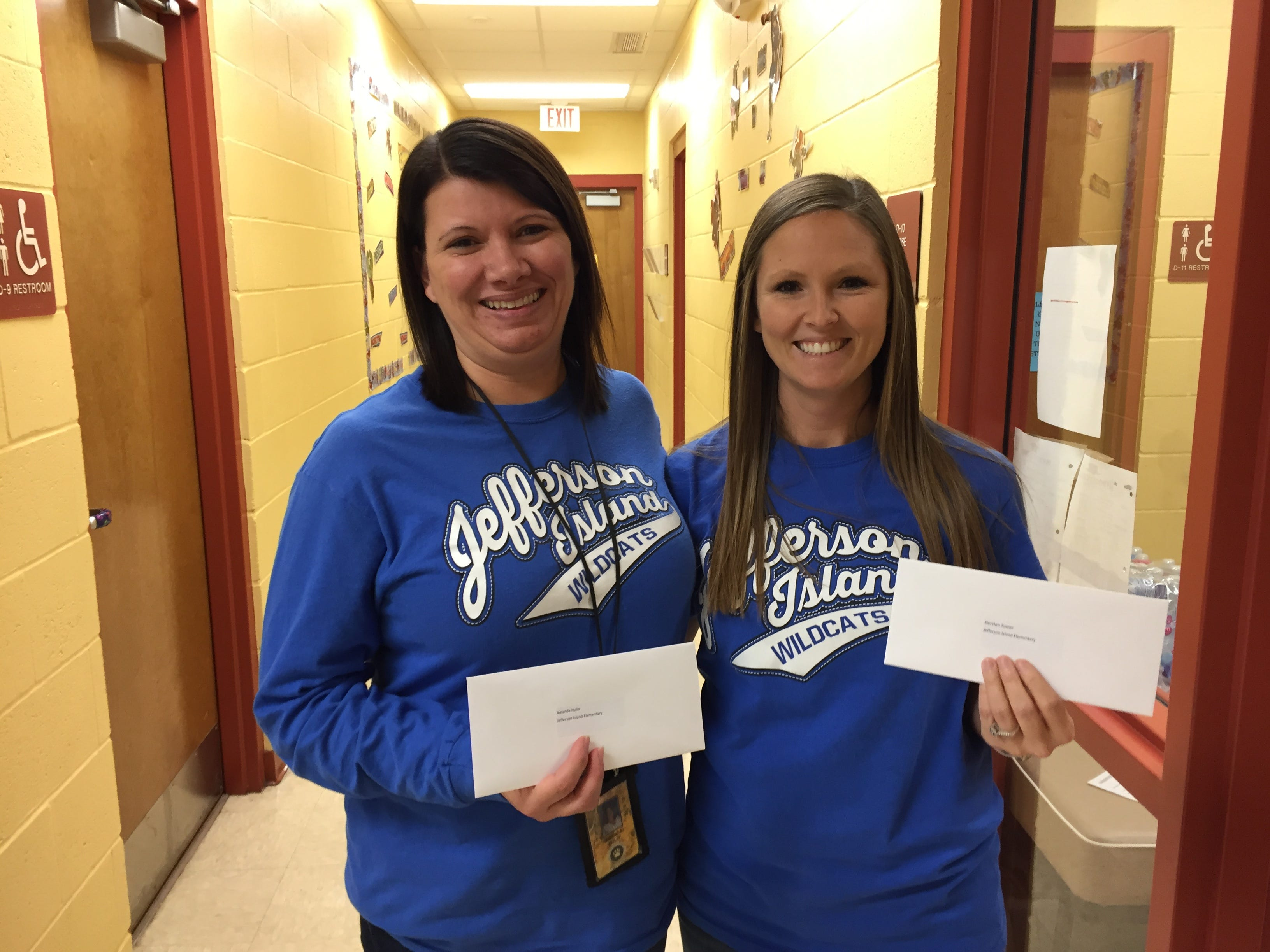 Jefferson Island Elementary teachers Amanda Hulin, left, and Kiersten Turner each received a gift card as a part of The Daily Advertiser's Adopt-A-Teacher drive.  Energy Transfer provided a $25,000 donation and Community Foundation of Acadiana assisted in securing gift cards for more than 400 teachers at 134 schools.