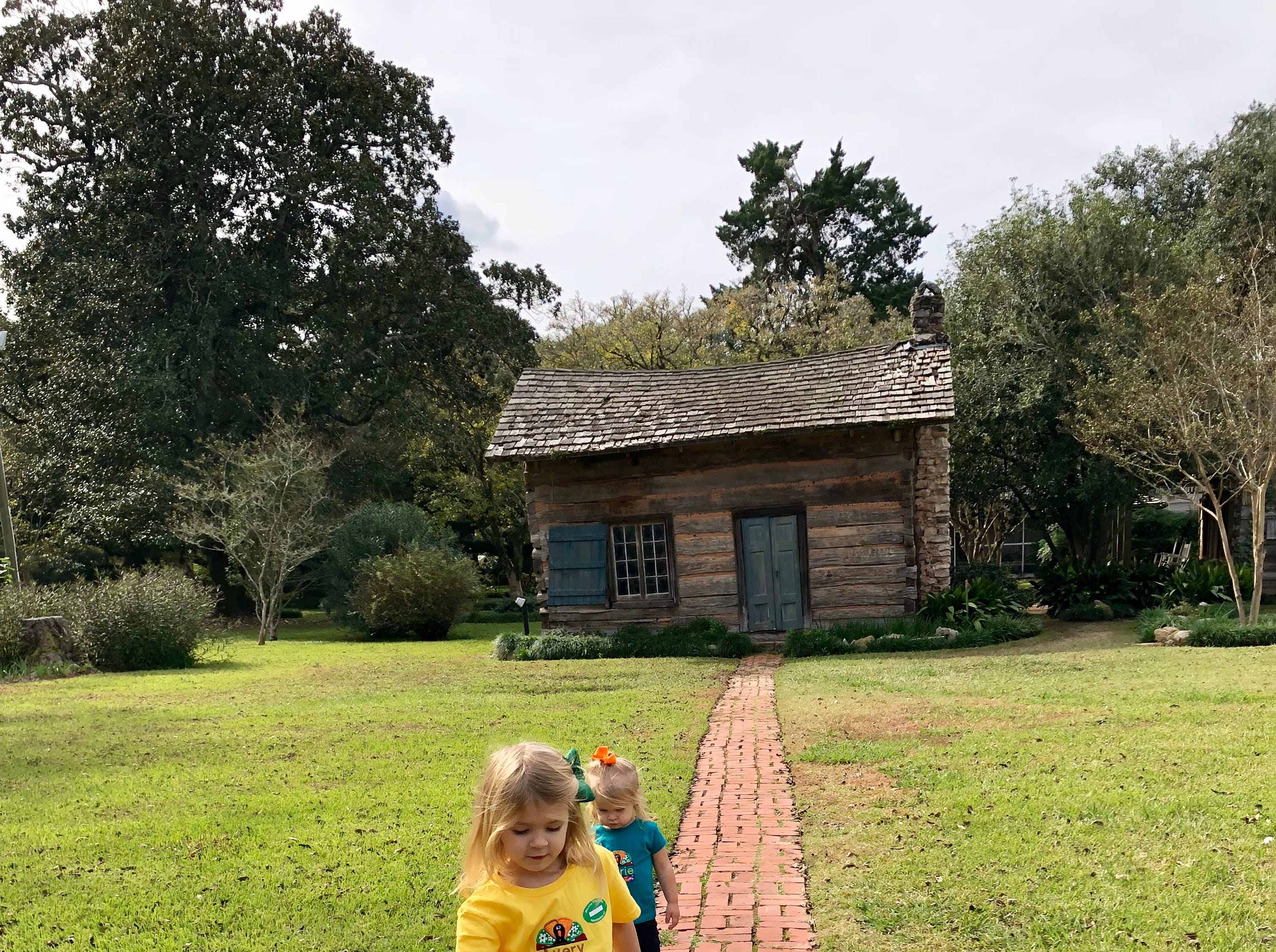 Sisters Avery and Marie Guidry take the grounds tour of Melrose Plantation in Cloutierville, Natchitoches Parish, as they explore the Cane River Creole National Heritage Trail Nov. 17, 2018.
