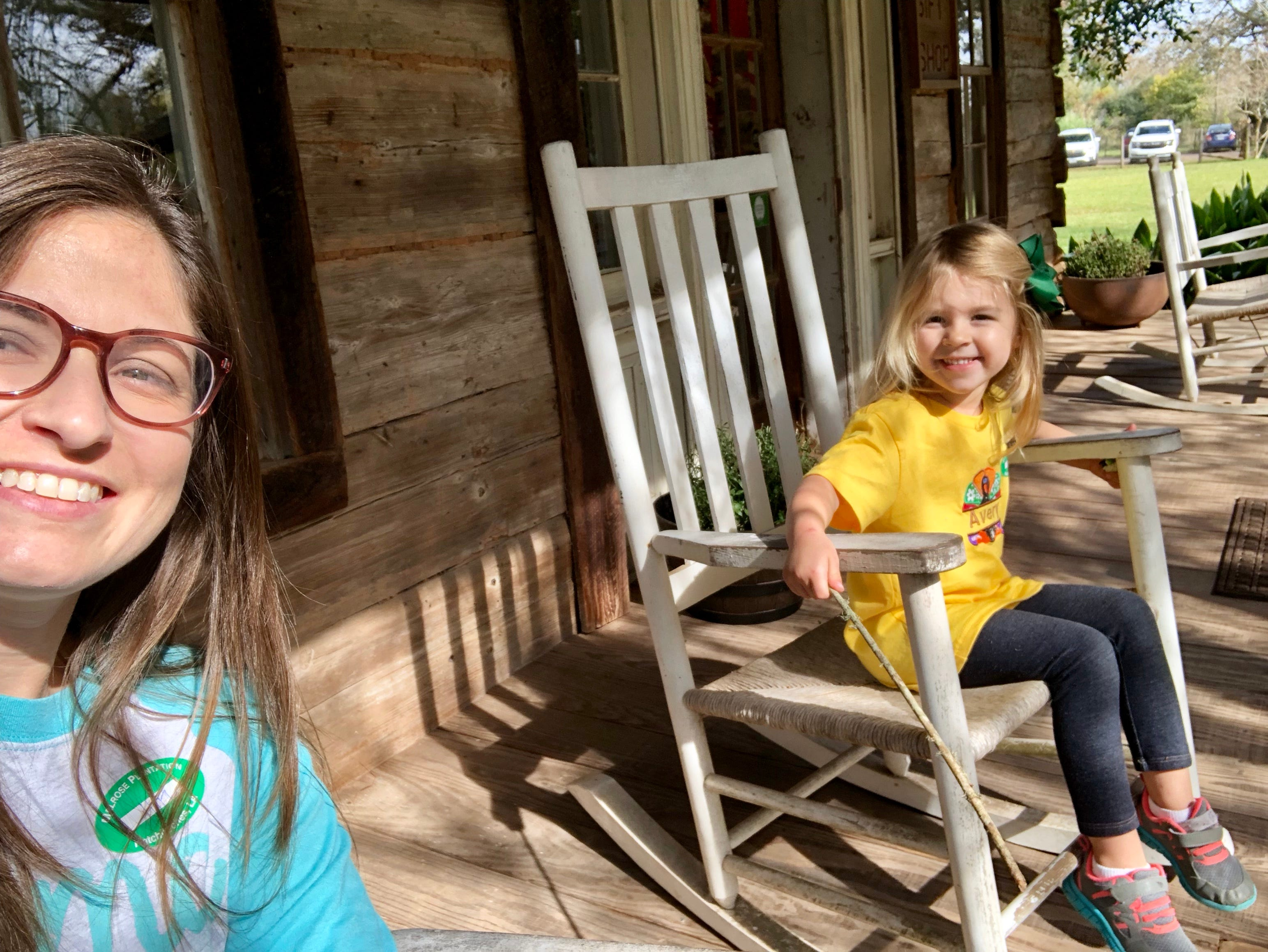 Travel and tourism reporter Leigh Guidry and daughter Avery, 4, rock on the porch of one of the buildings that make up Melrose Plantation in Cloutierville, Natchitoches Parish.