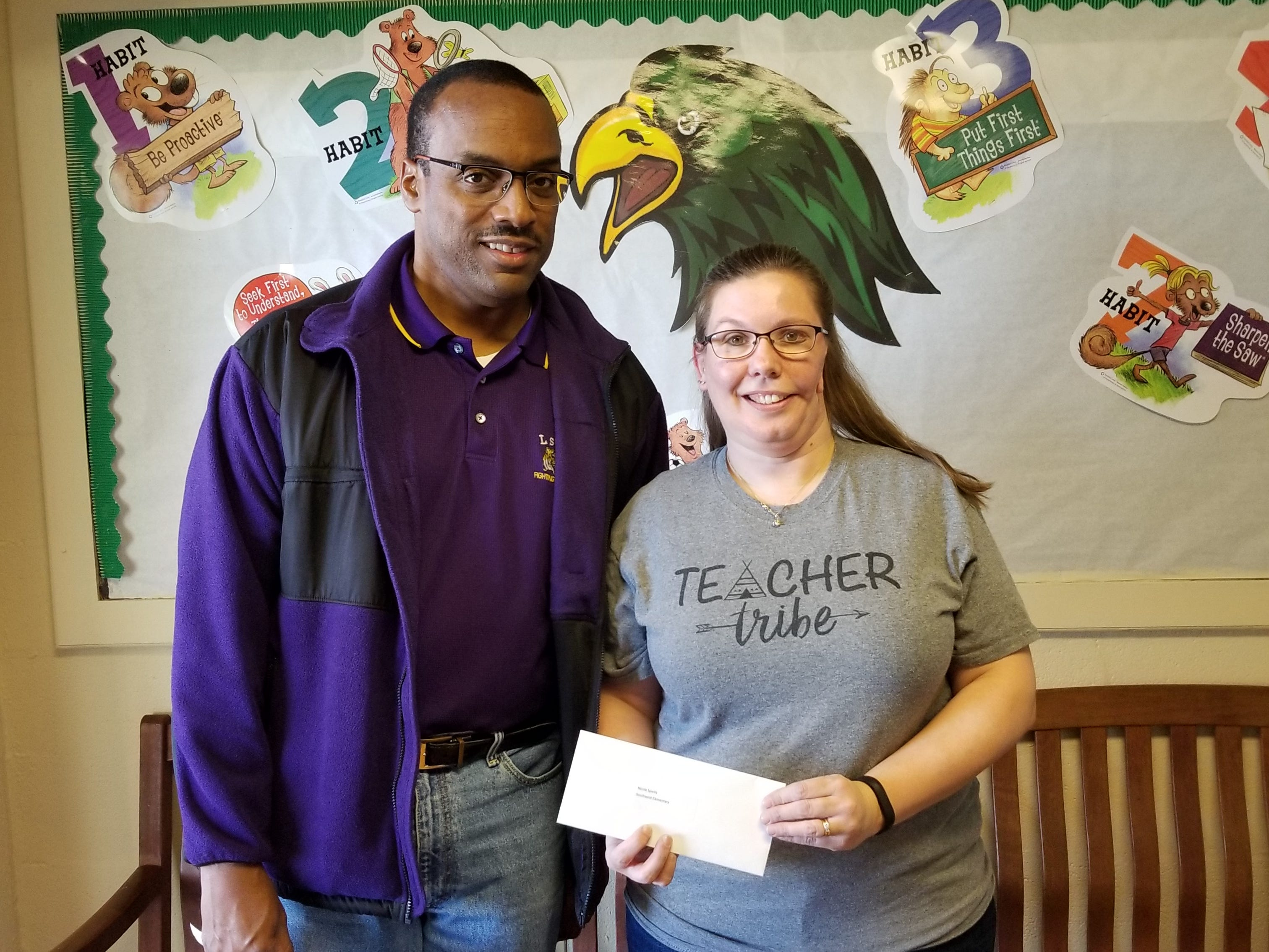 Southwest Elementary School teacher Nicole Sparks, right, received a gift card from Herman Fuselier as a part of The Daily Advertiser's Adopt-A-Teacher drive.  Energy Transfer provided a $25,000 donation and Community Foundation of Acadiana assisted in securing gift cards for more than 400 teachers at 134 schools.
