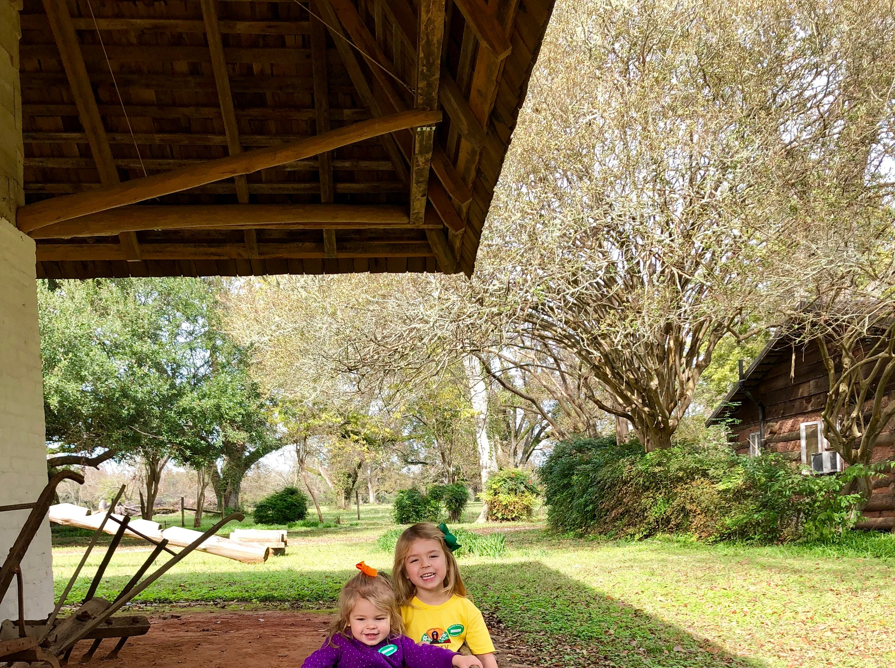Avery and Marie Guidry discover an historic canoe made from a log on the grounds of Melrose Plantation in Cloutierville.