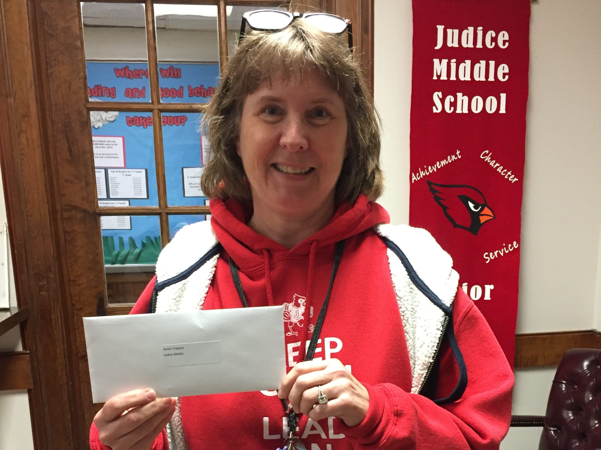 Judice Middle School teacher Karen Trappey received a gift card as a part of The Daily Advertiser's Adopt-A-Teacher drive.  Energy Transfer provided a $25,000 donation and Community Foundation of Acadiana assisted in securing gift cards for more than 400 teachers at 134 schools.