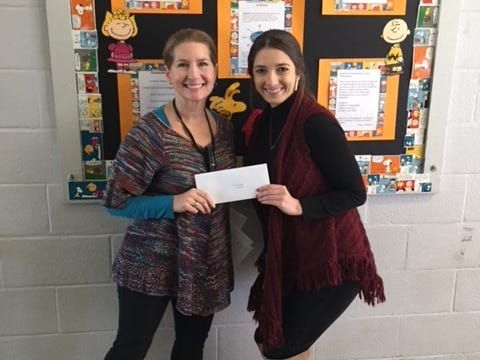 Traci Granger, left, a teacher at Cankton Elementary school, received a gift card from Katie Johnston as a part of The Daily Advertiser's Adopt-A-Teacher drive.  Energy Transfer provided a $25,000 donation and Community Foundation of Acadiana assisted in securing gift cards for more than 400 teachers at 134 schools.