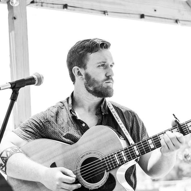 Derrick Savoie performs Saturday at the Blue Dog Cafe in Lafayette.