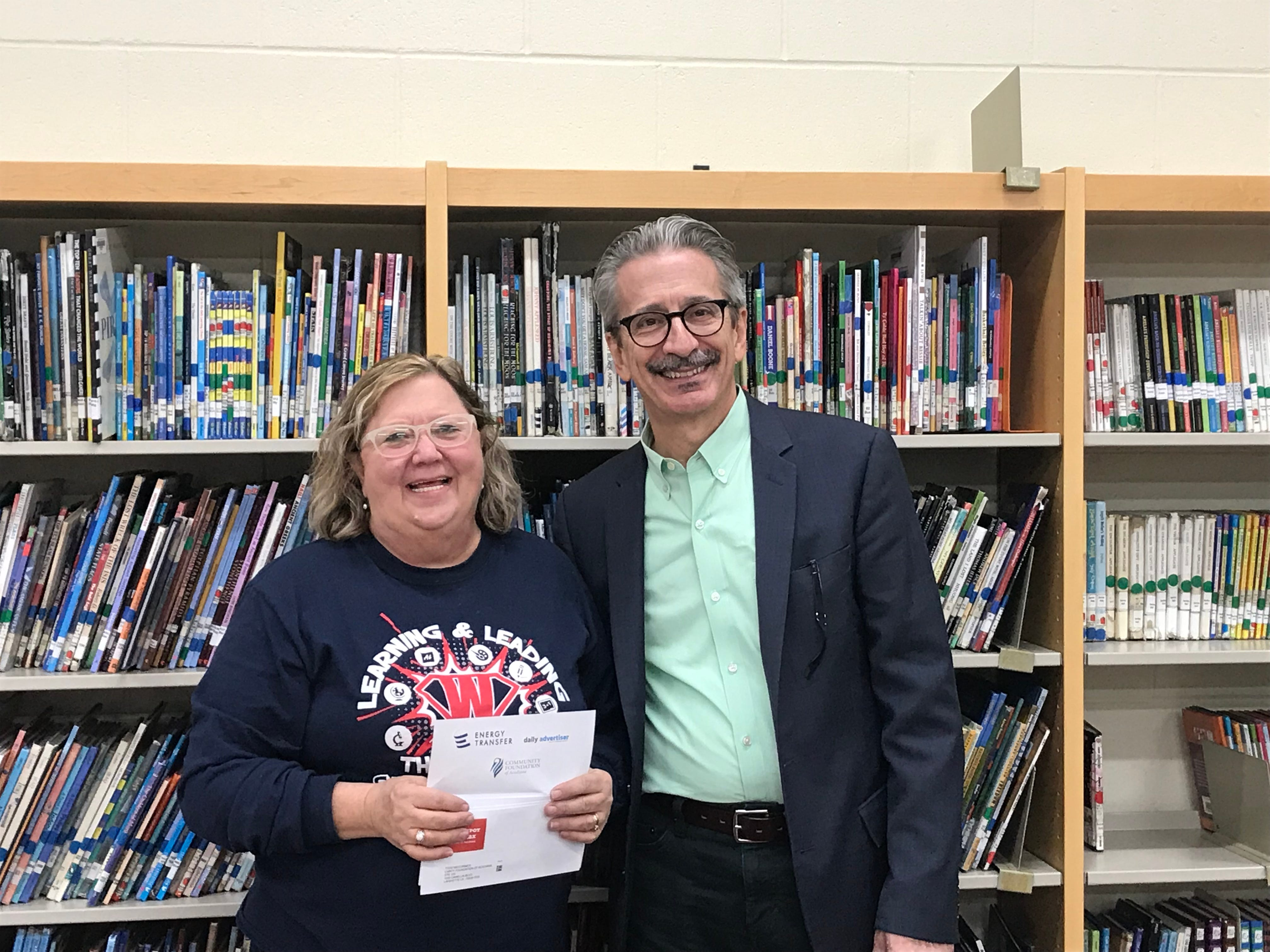 James Flachsenhaar, right, with a Westside Elementary School teacher who received a gift card as a part of The Daily Advertiser's Adopt-A-Teacher drive.  Energy Transfer provided a $25,000 donation and Community Foundation of Acadiana assisted in securing gift cards for more than 400 teachers at 134 schools.