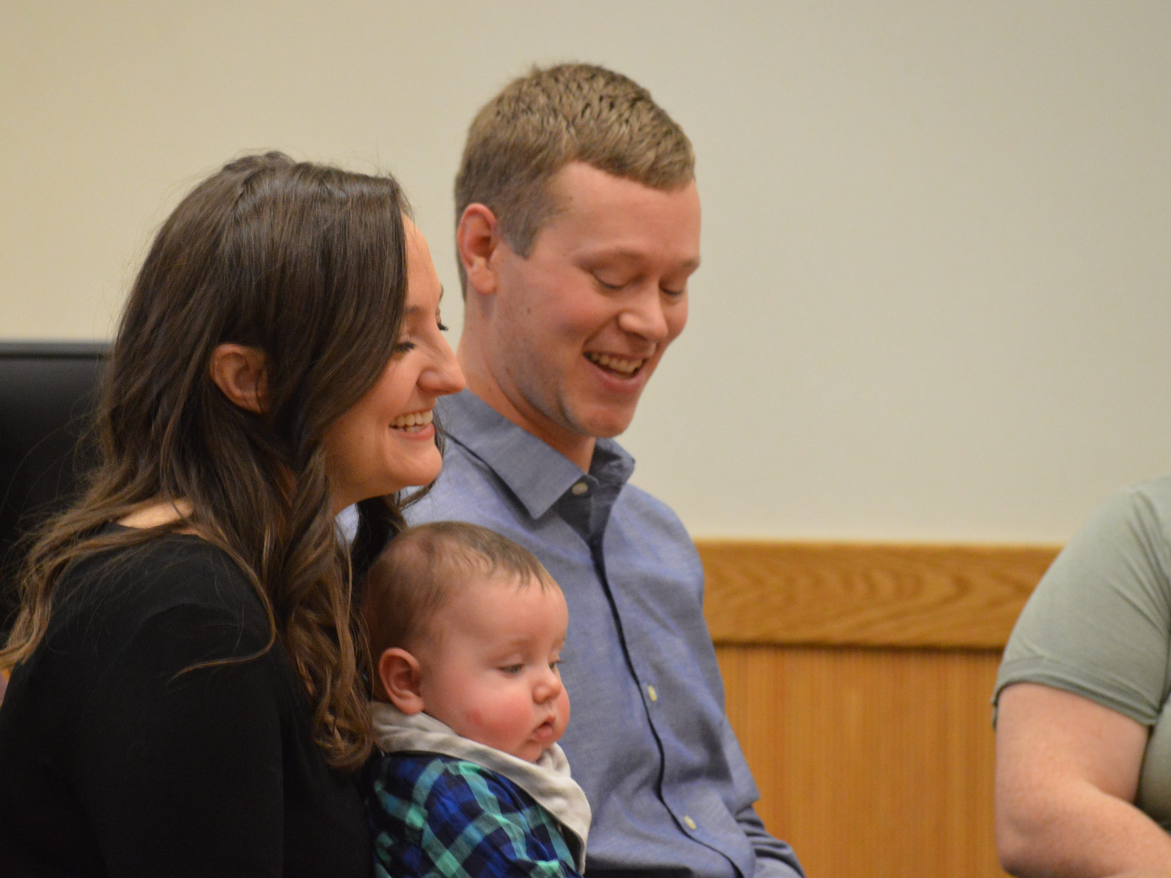 Chad and Christine laugh during the finalization of their son Wyatt's adoption on Nov. 20, 2018.