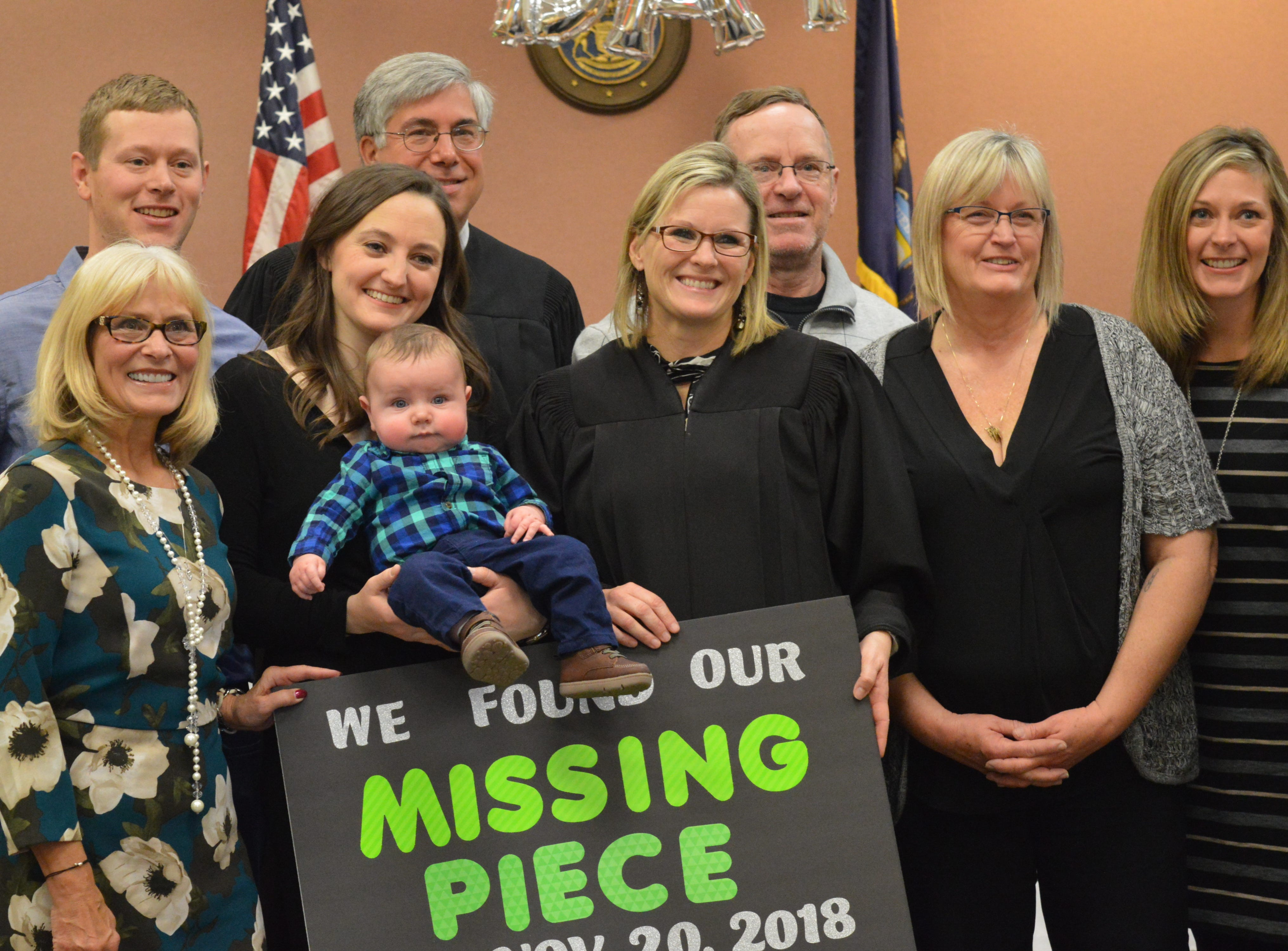 The Church family poses with Livingston County Chief Judge Miriam Cavanaugh and Michigan Court of Appeals Judge Christopher Murray after their son's adoption was finalized. He was adopted on Nov. 20, 2018.