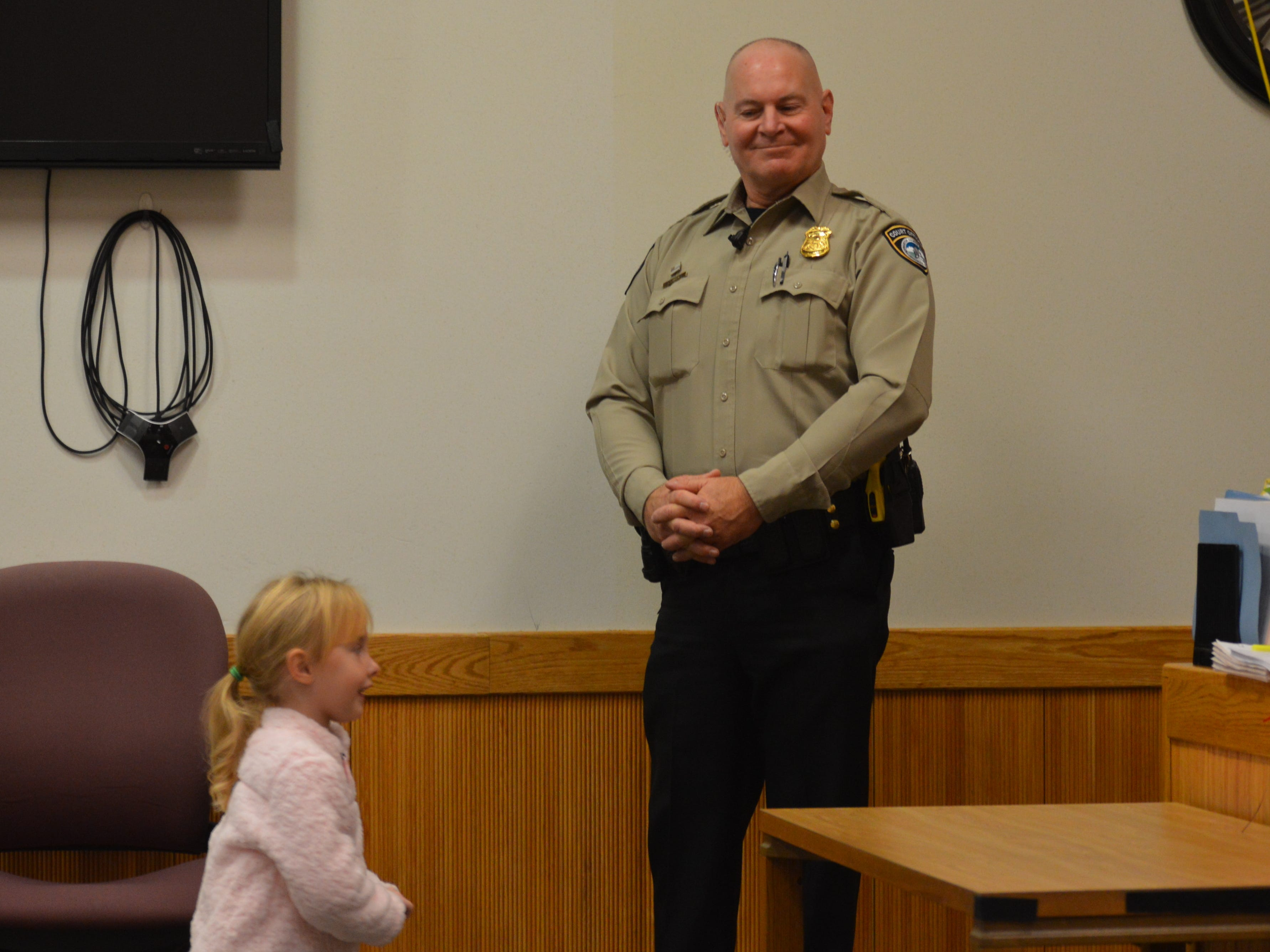 Layla Drew, newly adopted by her father runs to the judge's bench to get her stuffed bear. She was adopted Nov. 20, 2018.