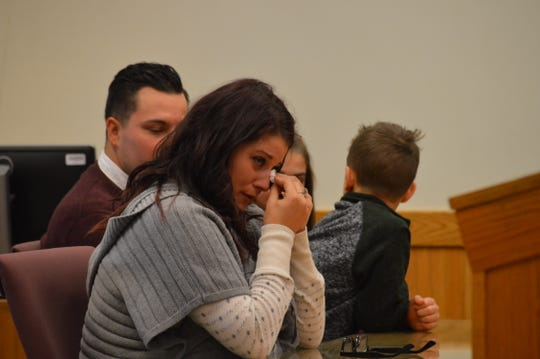 Danielle Elliot cries as she tells Livingston County Chief Judge Miriam Cavanaugh what the adoption of her children means to her on Nov. 20, 2018.