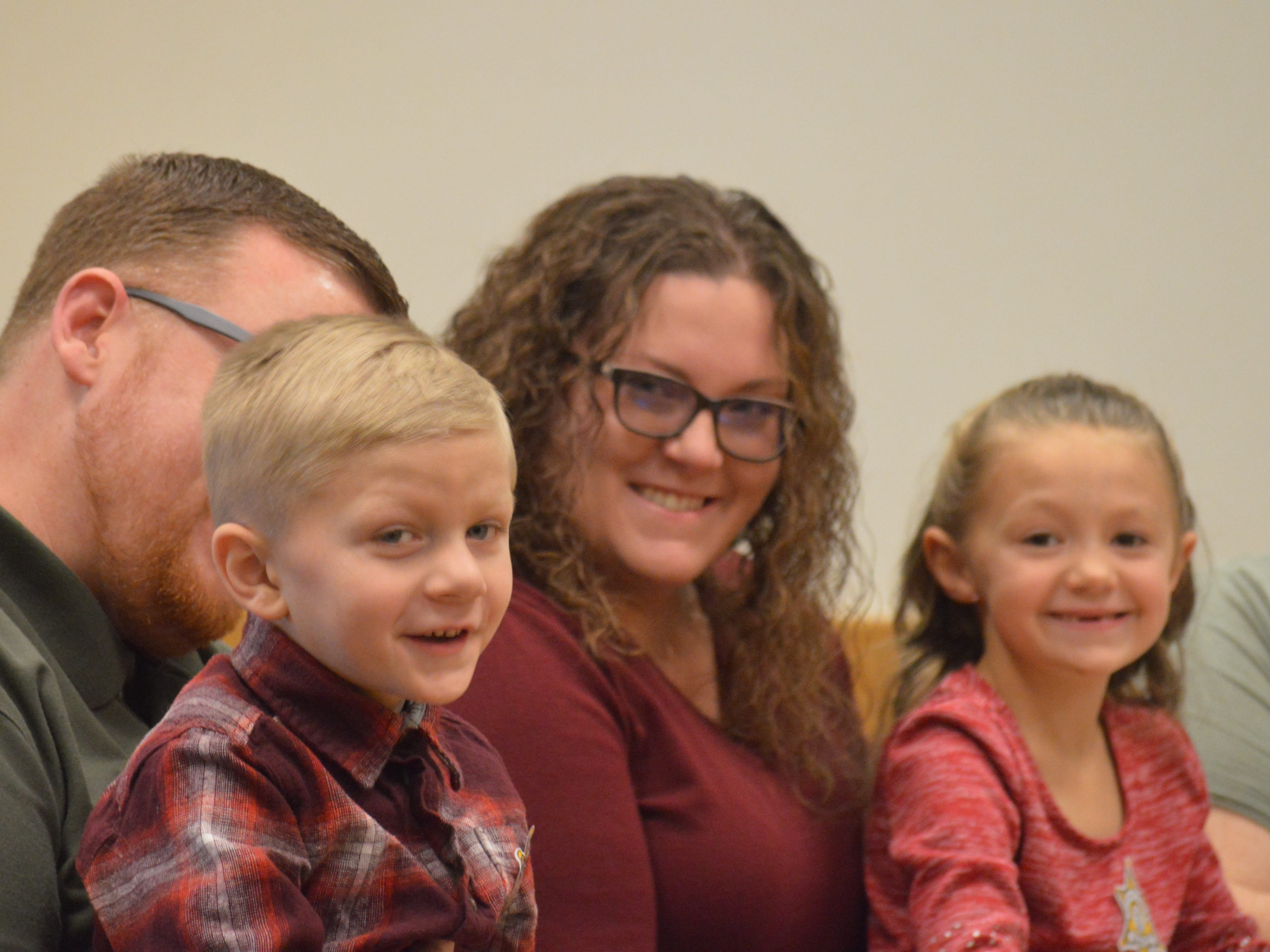 New parents Jeffrey and Erica Poag sit with their two children Jayden and Angel in Livingston County Chief Judge Miriam Cavanaugh's courtroom. The adoptions were finalized on Nov. 20, 2018.