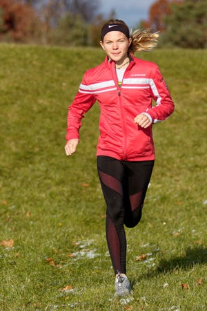 Pinckney senior Noelle Adriaens is Livingston County's girls cross country Runner of the Year.
