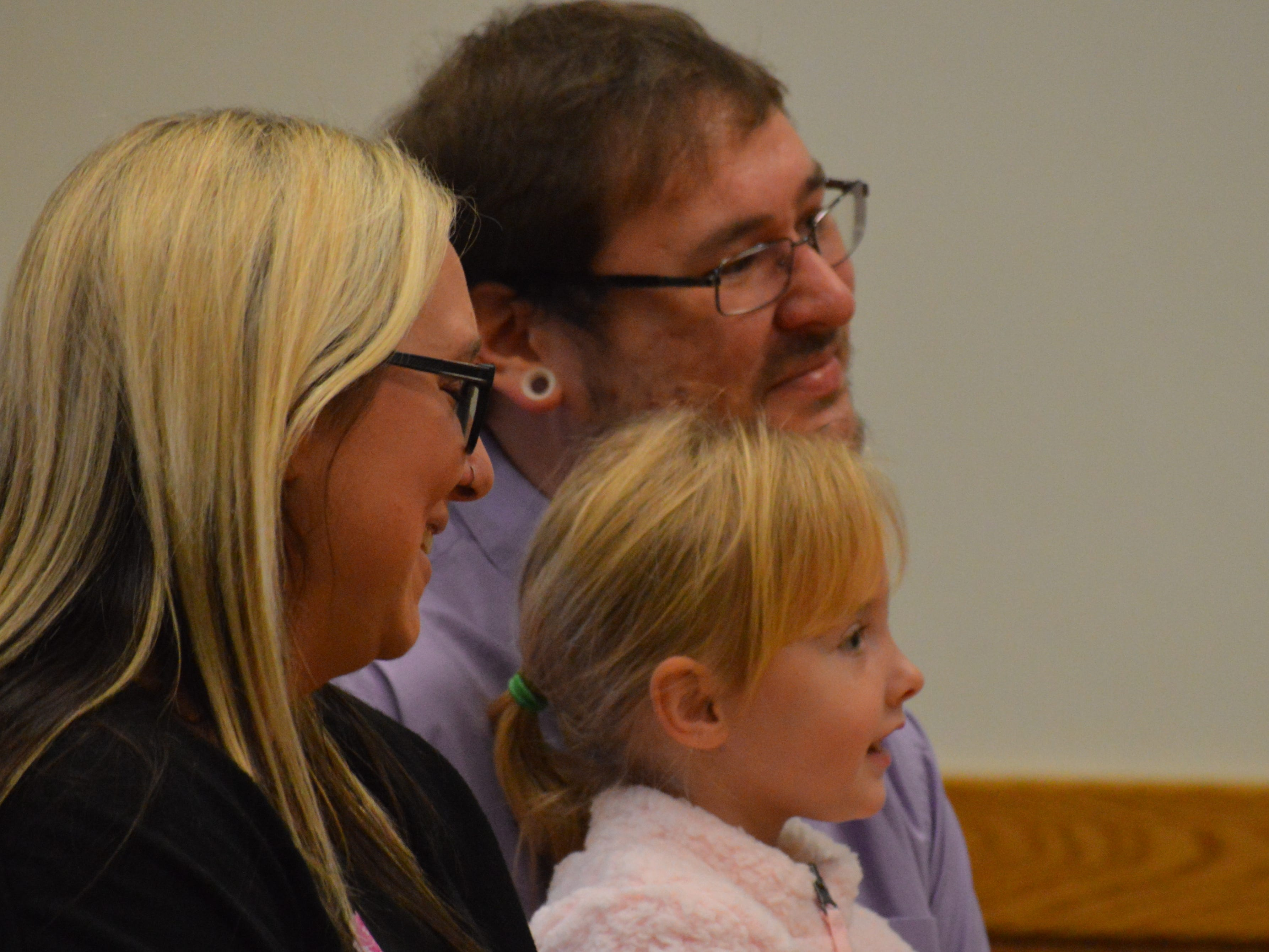 Jessica and Alexander Drew, with their daughter Layla, address Livingston County Chief Judge Miriam Cavanaugh on Tuesday Nov. 20, 2018. Layla was legally adopted by Alexander.
