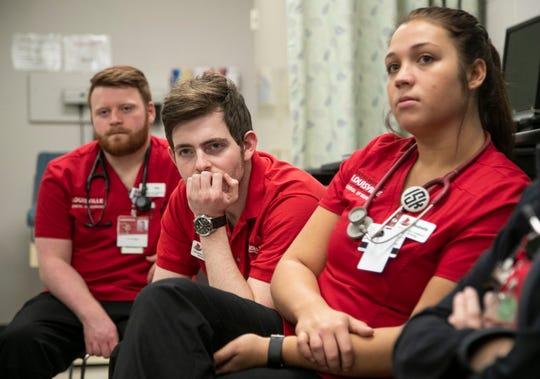 UofL Nursing student Cody Swift listens with other students during a review of their training session. Around 1.1 million job openings for nurses are projected to exist by 2024, according to the American Association of Colleges of Nursing, but enrollment at nursing schools isn't growing fast enough to meet the anticipated demand.