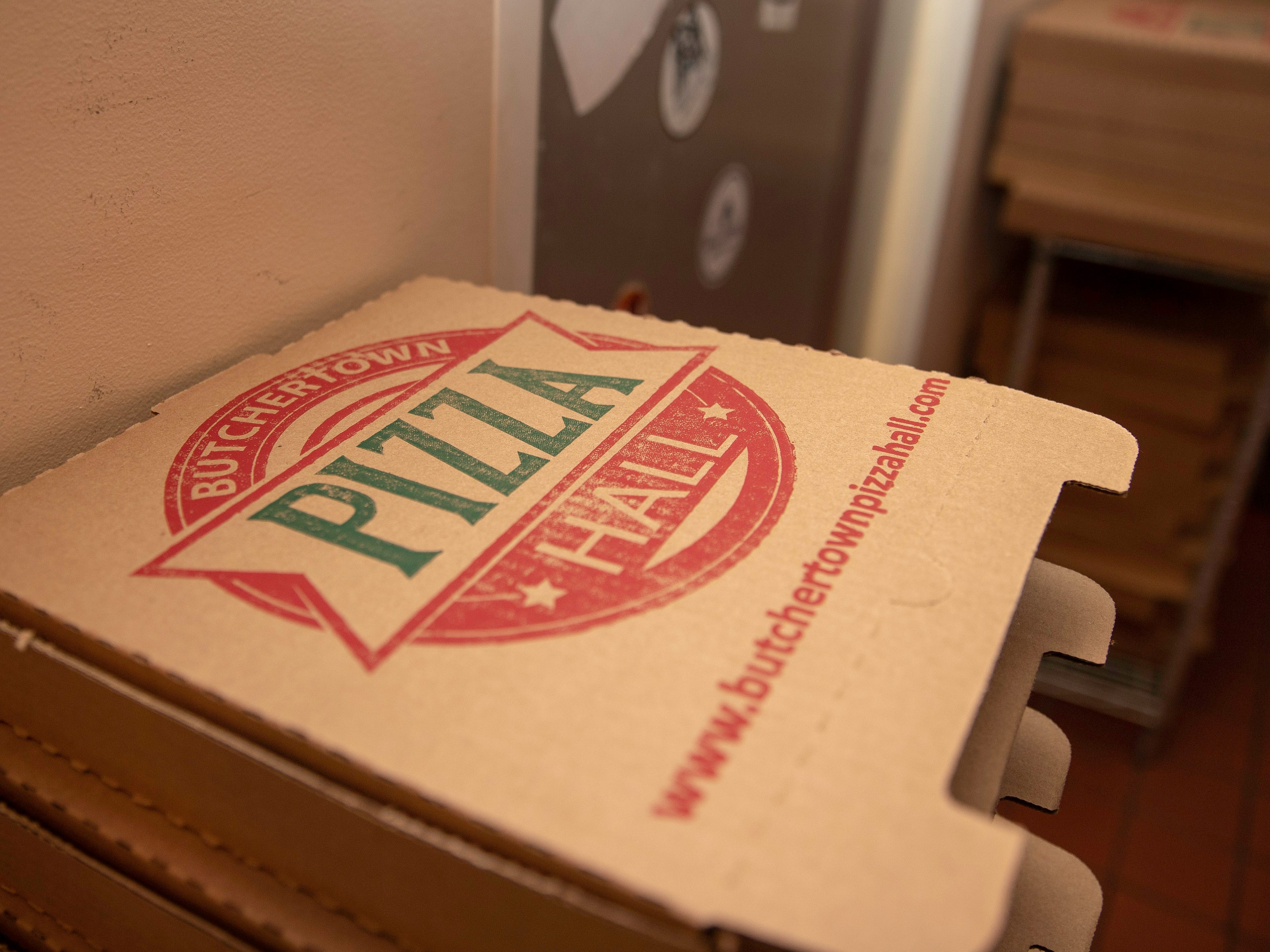 Pizza boxes stacked and ready for to-go pies or leftover slices at Buthertown Pizza Hall, Wednesday, Nov. 7, 2018 in Louisville Ky.