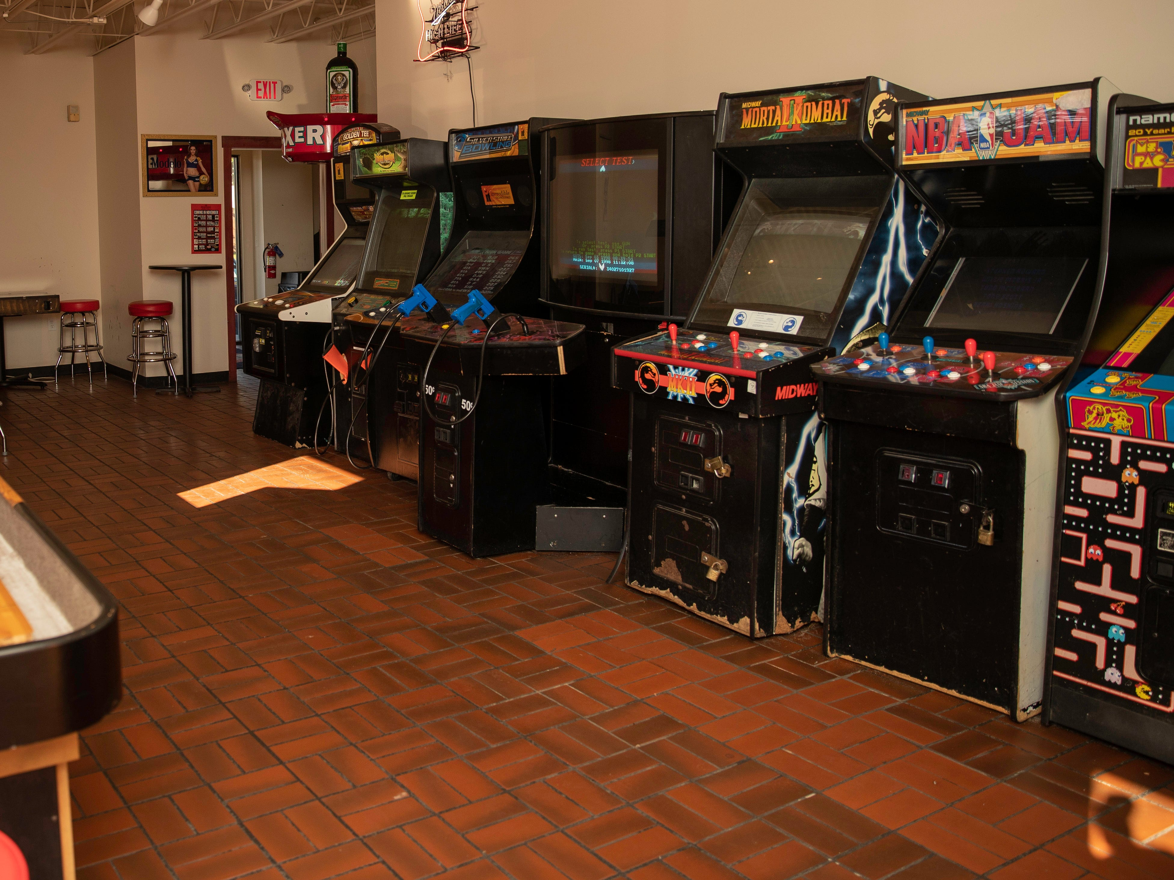 Game room off the rear parking lot entrance offers vintage and newer arcade games as well as table shuffleboard at Butchertown Pizza Hall.