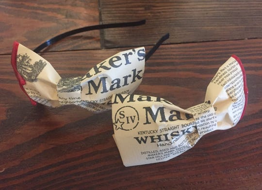 Melissa Sinkovic crafted these Makers Mark fashion accessories, a headband for the ladies and a bow tie for men, available at Revelry Boutique.