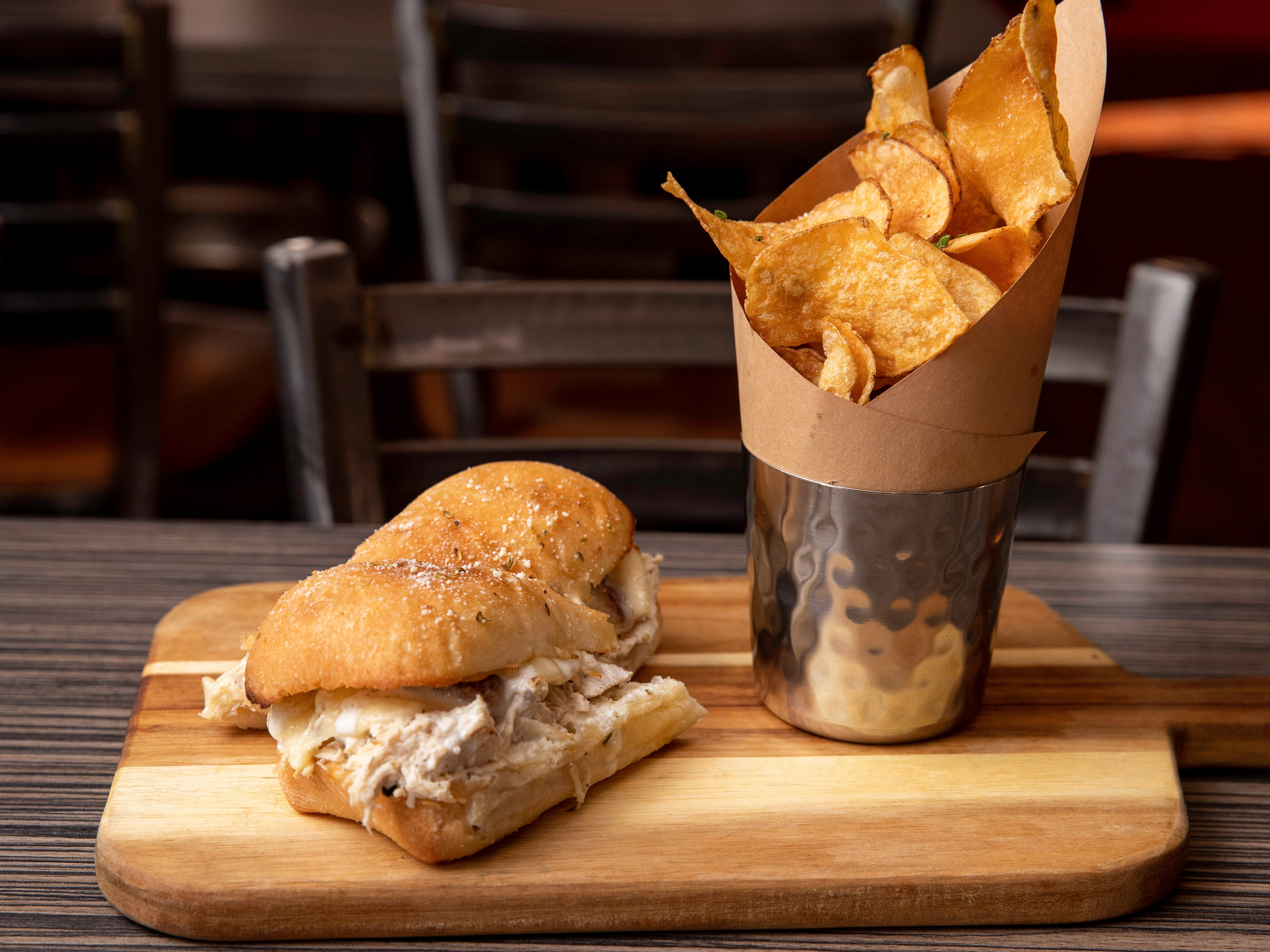 Roasted Chicken Sandwich (roasted chicken breast, house cured bacon, ranch, provolone cheese) with house made potato chips at Butchertown Pizza Hall, Wednesday, Nov. 7, 2018 in Louisville Ky.