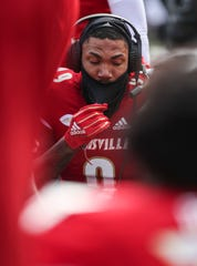 Wide receiver Jaylen Smith of Louisville sits on the sideline during the game against North Carolina State.