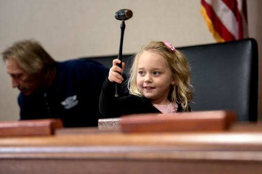 Alayna Fletcher, 4, slams down the gavel finalizing the adoption of her and her brother Austin, 7, during a Michigan Adoption Day ceremony at the Clinton County Courthouse in St. Johns. Four families finalized the adoptions of six children.