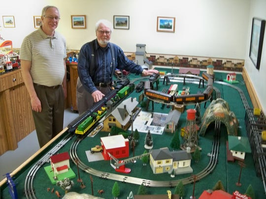 Clipper City Model Railroad Club will hold its Thanksgiving show. Pictured with G-gauge layout are club members Rick Hoffman and Paul Kopidlansky.