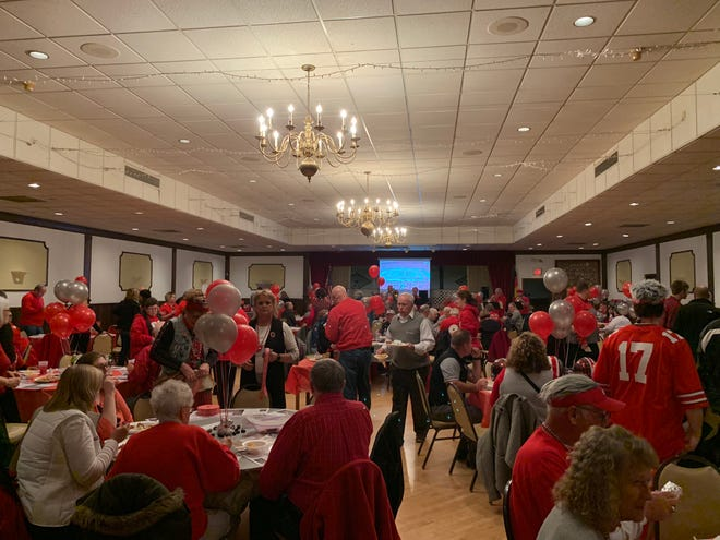 Hundreds of Ohio State University fans pack the Mansfield Liederkranz Monday, Nov. 19, to celebrate the 38th annual Buckeye Bash.