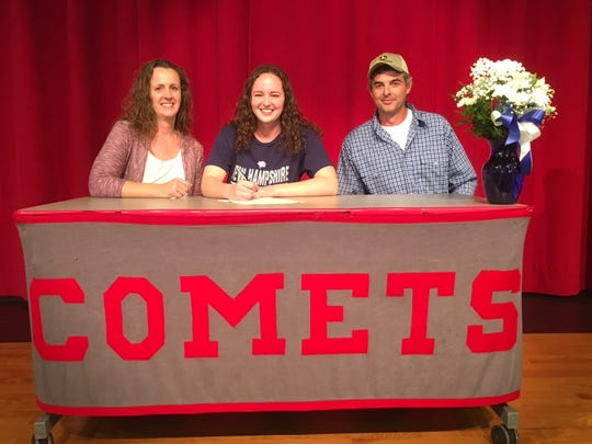 Elgin's Madison Linstedt, center, poses with her parents as she signs her national letter of intent to swim at New Hampshire.