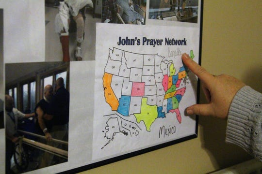 Victoria Nagel points to a map that her husband had kept in his room, while undergoing intensive physical therapy in the early months of 2017. He colored in states where people were praying for him.