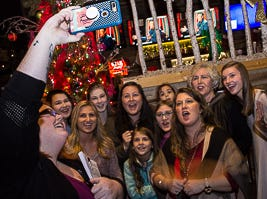 Mandy thomas taking a selfie with family and fellow Voice students  during the watch party for friends and family at Kooky Canuck in Cordova.
