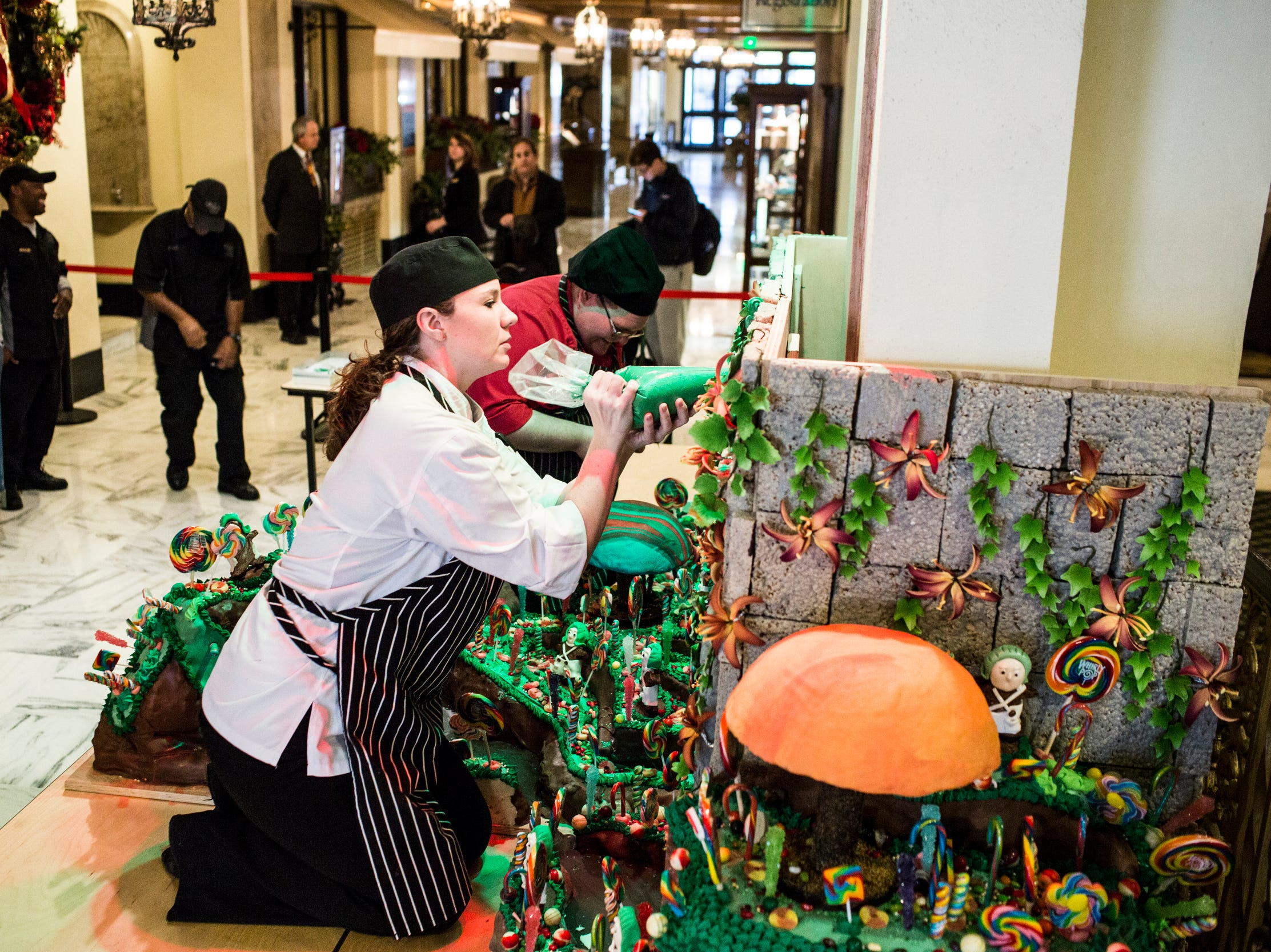November 20 2018 - Elaine Jones, assistant pastry chef, adds frosting to the holiday gingerbread display at the Peabody Hotel. Chef Konrad Spitzbart does an elaborate holiday Gingerbread display every year that work is started on months in advance.