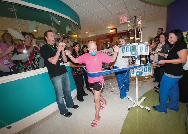 Hillary Husband's St. Jude medical team celebrates as she completes the equivalent of a marathon inside the hospital in 2013 following a bone marrow transplant.