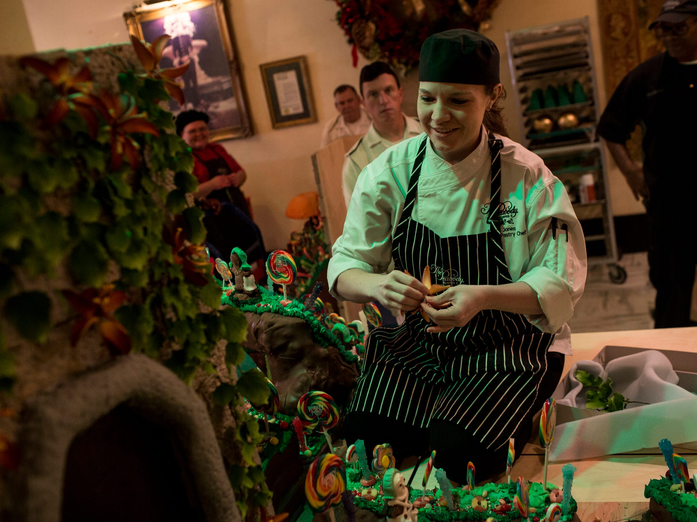 November 20 2018 - Elaine Jones, assistant pastry chef, adds details to the holiday gingerbread display at the Peabody Hotel. Chef Konrad Spitzbart does an elaborate holiday Gingerbread display every year that work is started on months in advance.