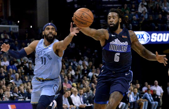 Memphis Grizzlies guard Mike Conley (11) and Dallas Mavericks center DeAndre Jordan (6) struggle for control of the ball in the first half of an NBA basketball game Monday, Nov. 19, 2018, in Memphis, Tenn. (AP Photo/Brandon Dill)