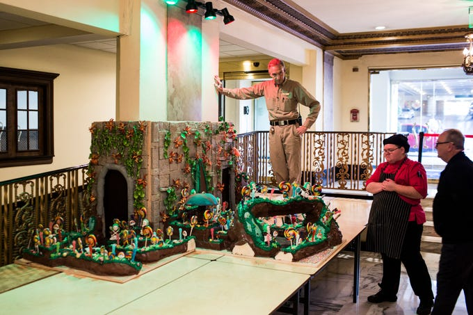 November 20 2018 - Mark Welch stands over the under construction gingerbread display while helping piece it together at the Peabody Hotel. Chef Konrad Spitzbart does an elaborate holiday Gingerbread display every year that work is started on months in advance.