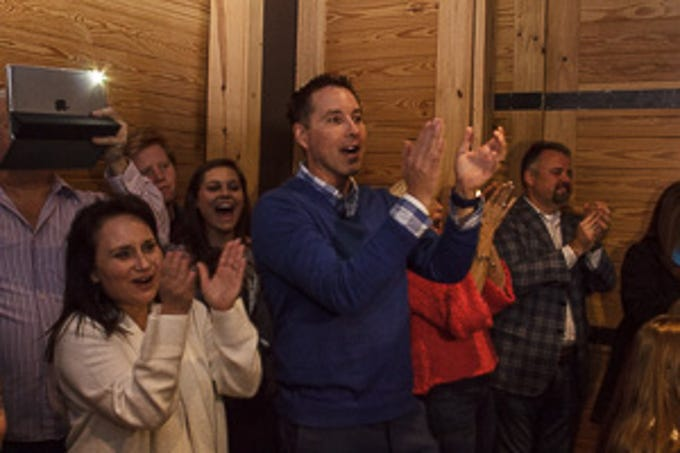 Todd Kucinsky Reagan's stepfather clapping after Reagan's performance live on NBC's The Voice during a watch party for friends and family at Kooky Canuck in Cordova.
