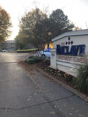 Police tape surrounds The Enclave Apartment Homes building on Hickory Meadow Lane on Nov. 20, 2018, where police said a 2-year-old was shot and killed.