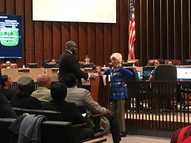 Memphis City Council Chairman Berlin Boyd presents outgoing Councilwoman Janis Fullilove with a proclamation at her last meeting on Tuesday, Nov. 20, 2018.