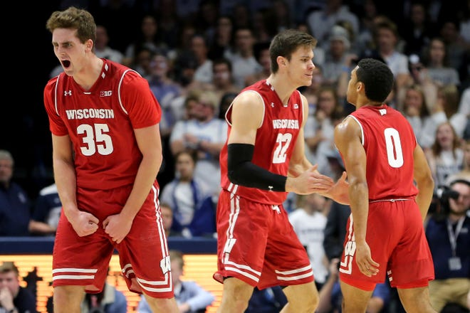 Wisconsin's Nate Reuvers (35), Ethan Happ (22) and D'Mitrik Trice (0), all key to the Badgers' success early this season, react to a play against Xavier.