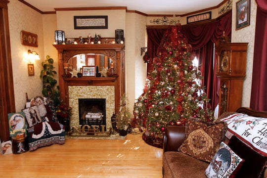 The Katonas' home has 14-foot ceilings, making it easy to fit a 10-foot tree in the parlor.