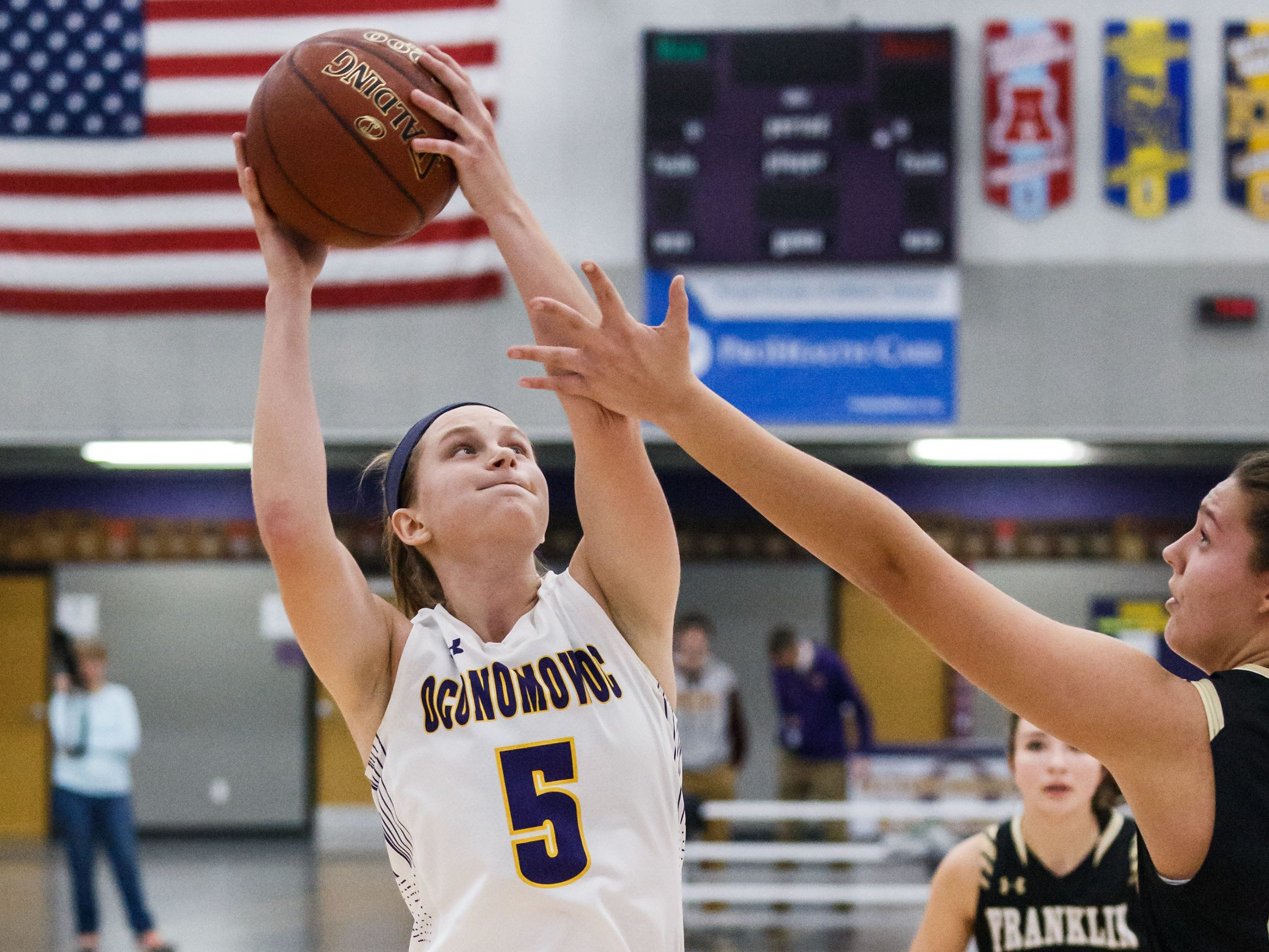 Oconomowoc junior Zoe Esveldt (5) pulls down a rebound during the game at home against Franklin on Monday, Nov. 19, 2018.