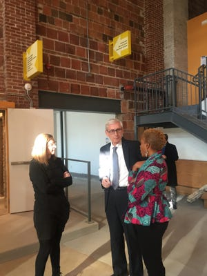 Gov.-elect Tony Evers (center) on Tuesday toured the Sherman Phoenix redevelopment project in Milwaukee with co-developers Juli Kaufmann (left) and JoAnne Sabir.