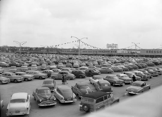 A sea of automobiles covered the parking lot at the new Bay Shore shopping center, north of Silver Spring Road in Glendale, within an hour after the center opened for the first time. At times an estimated 4,000 cars jammed the parking area.