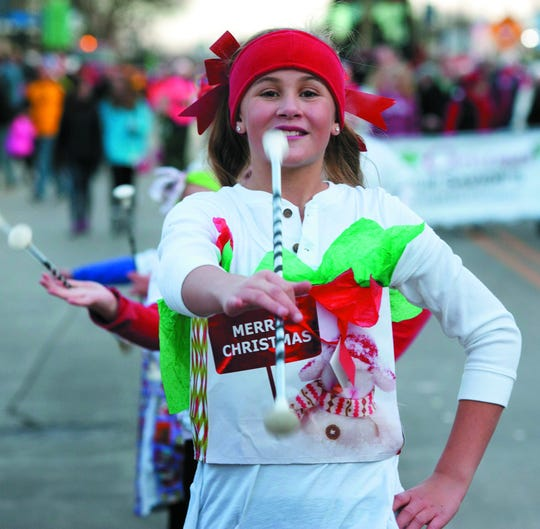The Oconomoc Christmas parade makes its way through downtown Saturday, Dec. 1.