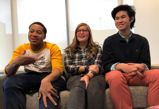Mario Walker (left), a resident adviser and sophomore from Milwaukee, talks about life in Marquette University's just-opened residence hall, The Commons. He's joined by fellow Commons residents Abigail Oye, a sophomore from Waukegan, Illinois, and Christian Cruz, a freshman from Wheeling, Illinois. All three are members of the residence hall's Community Programming Council.
