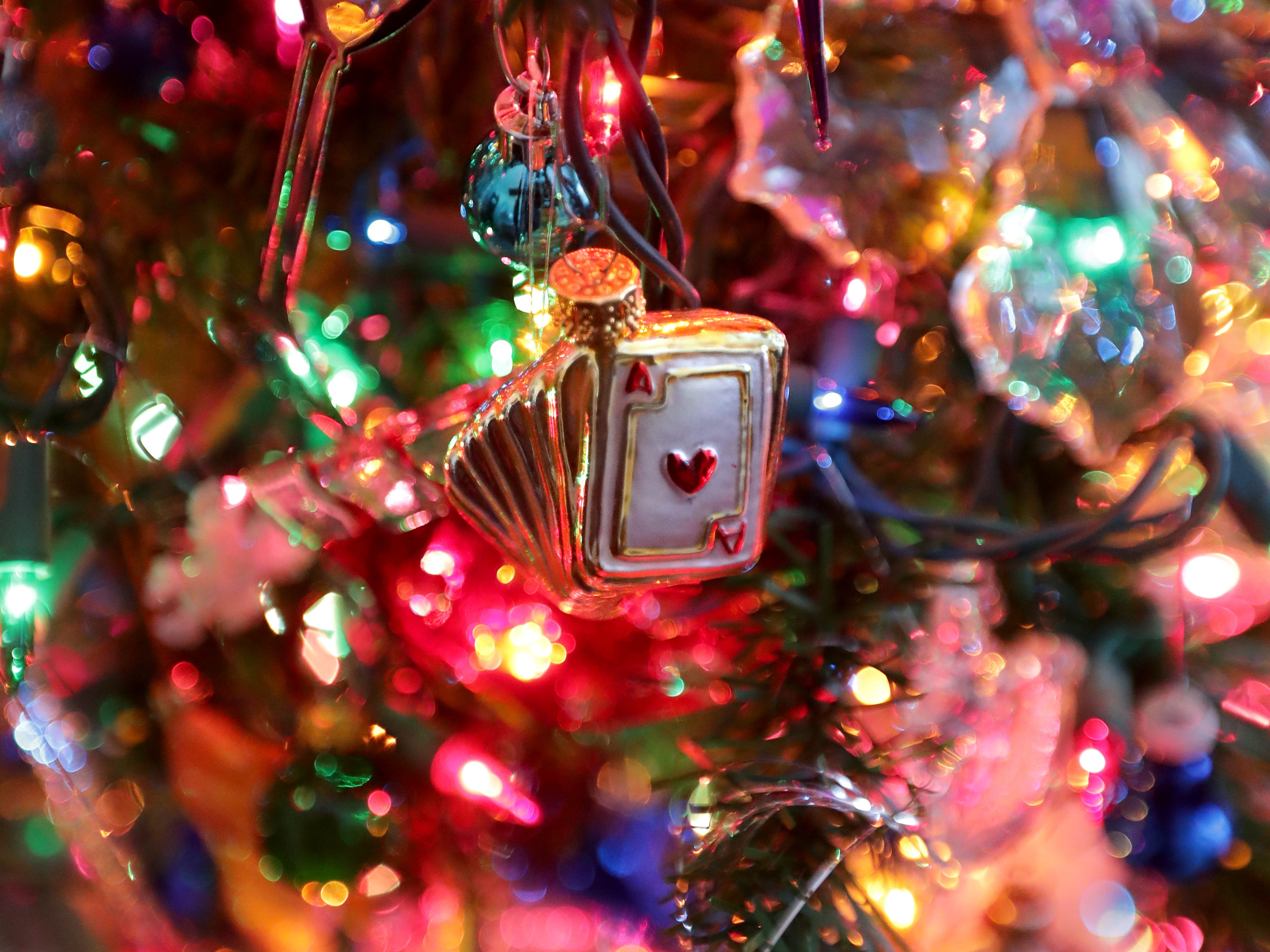 A small deck of cards ornament hangs on Kim Harrison's Christmas tree.
