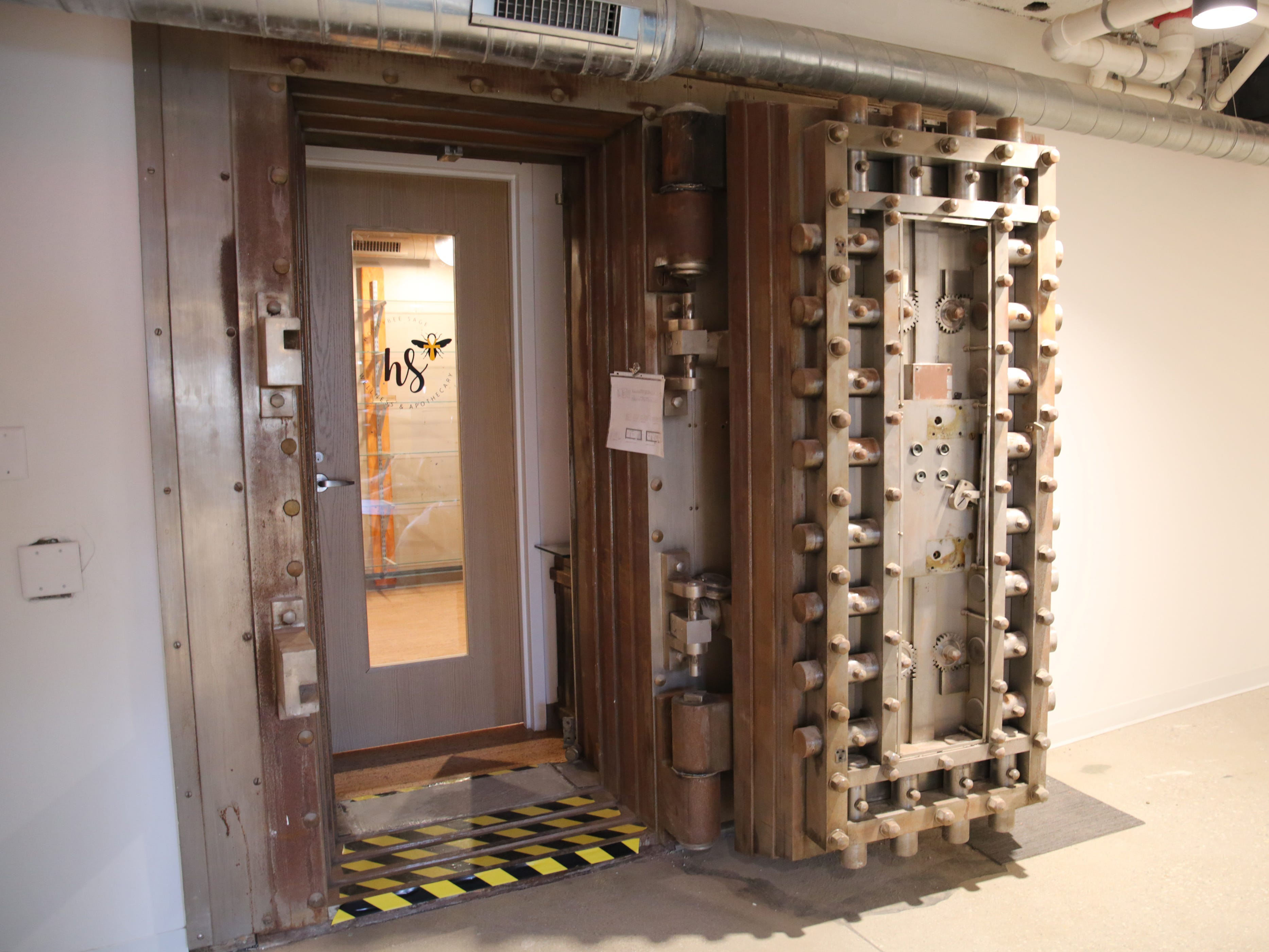 The old BMO Harris vault serves as an entrance to Honeybee and Sage Wellness.