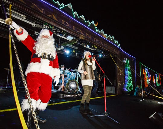 Santa makes an appearance as vocalist Kira Isabella and the band Doc Walker perform from the Canadian Pacific Holiday Train during its 2015 stop in Hartland.