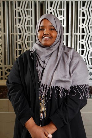 Juweriya Hassen, 17, poses for a portrait at Pulaski High School Nov. 15. A native of Somalia, Hassen is among 15 Pulaski students who will be featured in a new book and multimedia project by the Minneapolis-based nonprofit Green Card Voices.