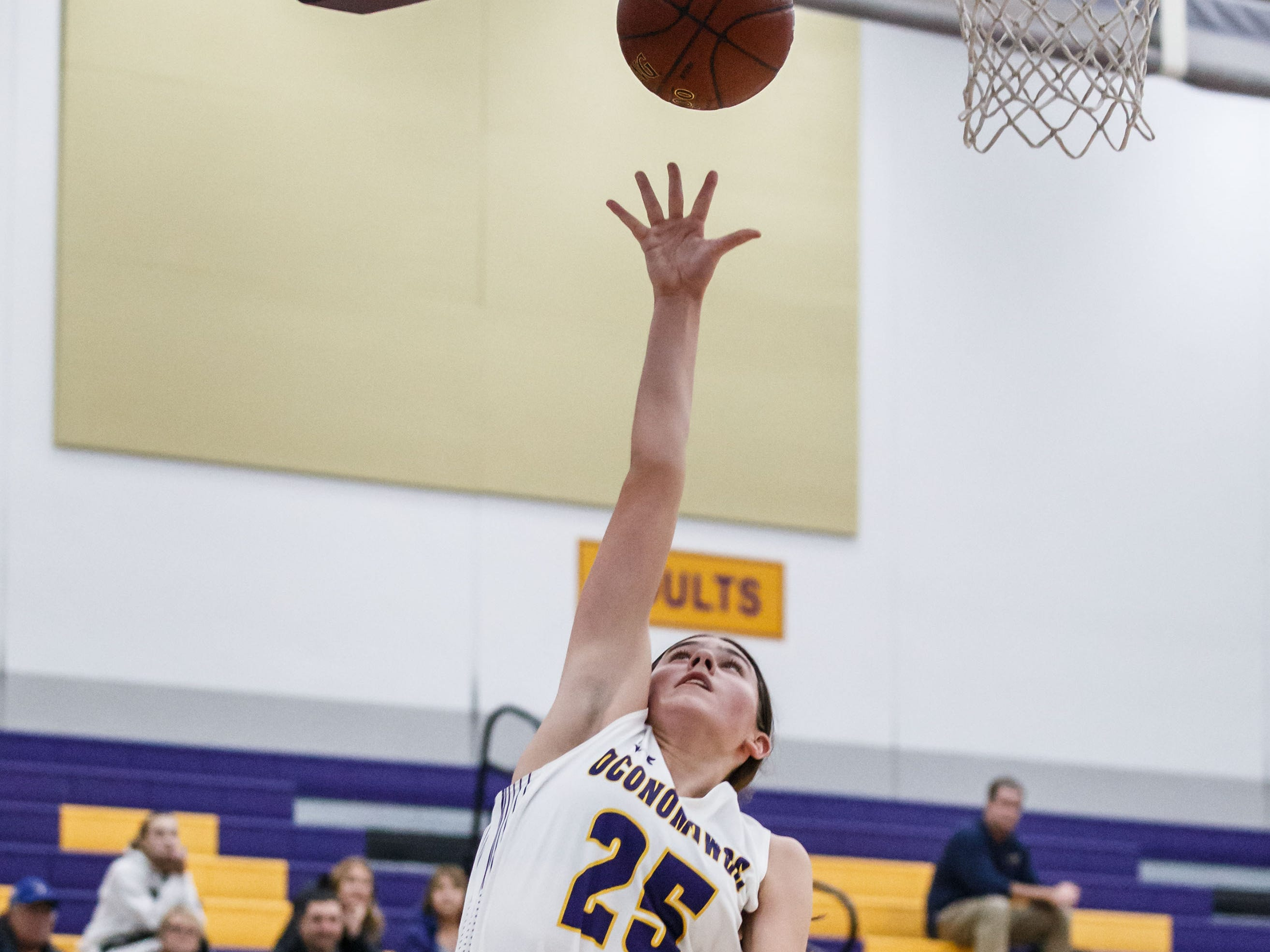 Oconomowoc freshman Natalie Gricius (25) drives in for a layup during the game at home against Franklin on Monday, Nov. 19, 2018.