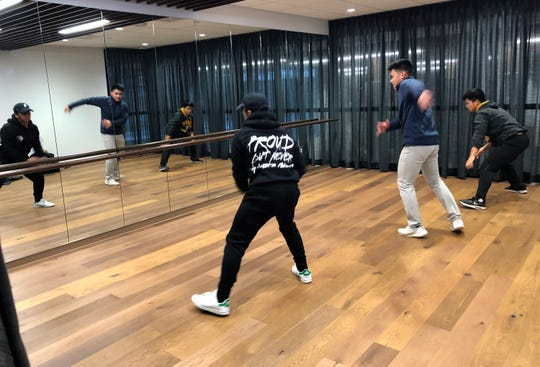 Marquette University freshmenAnthony Belbis (from left) ofNaperville, Illinois, Jacob Directo of San Diego, California, and Russell Sanchez of Skokie, Illinois, practicedance moves in a practice room in the new residence hall, The Commons. The three are part of a Philippines culture club.