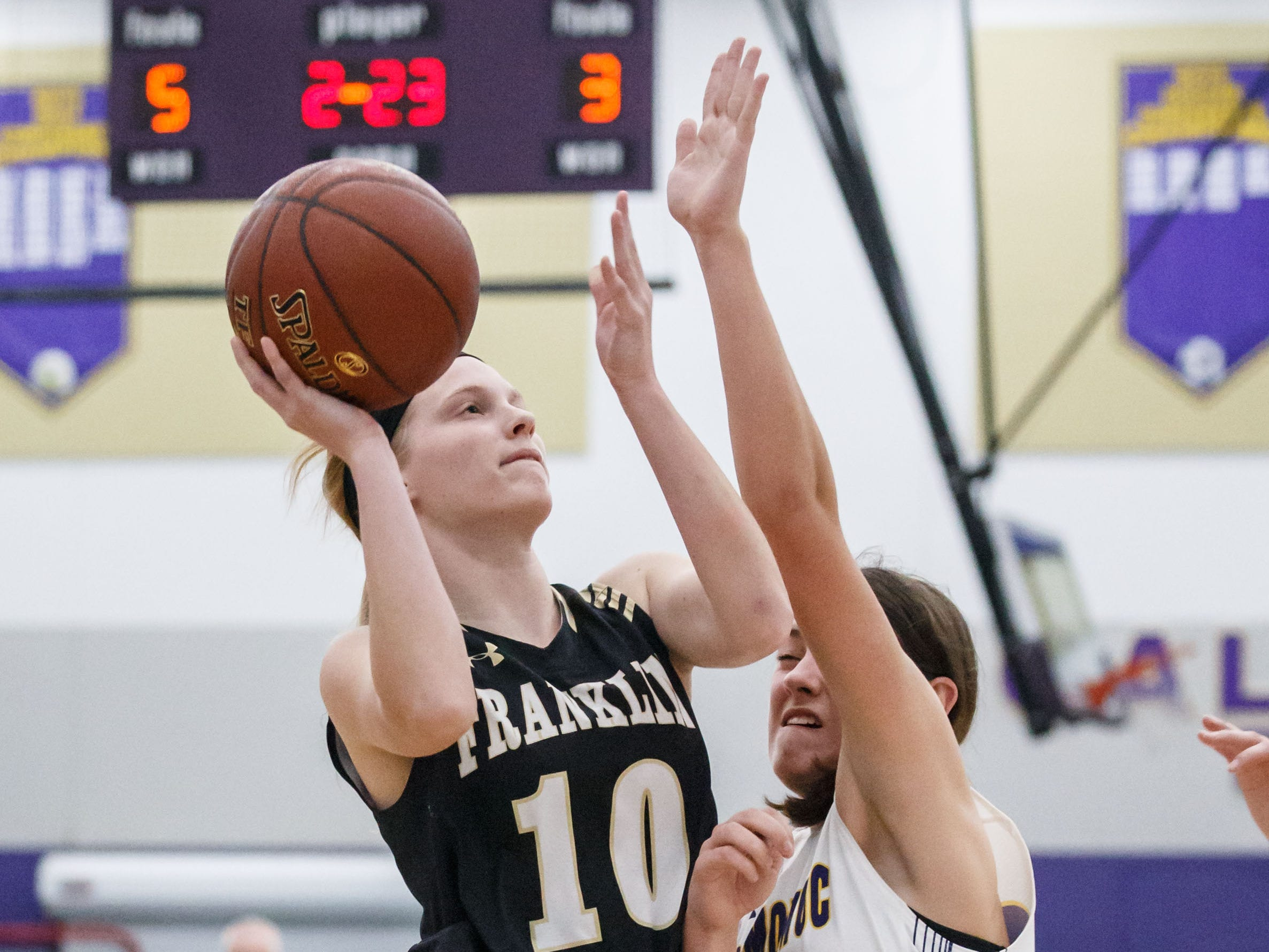 Franklin junior Lauren Schwartz (10) battles past Oconomowoc's Natalie Gricius (25) for a layup during the game at Oconomowoc on Monday, Nov. 19, 2018.
